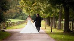 bride and groom walking down drive.jpg -